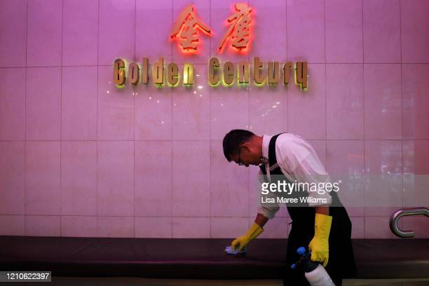 Restaurant waiter Ben cleans surfaces and hand railings at the award winning Golden Century Seafood Restaurant in Chinatown on March 05 2020 in...