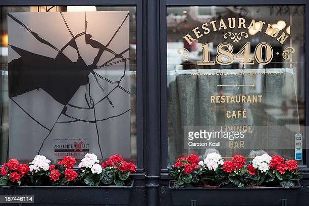 A restaurant window made to look like it has been smashed to commemorate the 75th anniversary of the Kristallnacht pogroms on November 9 2013 in...