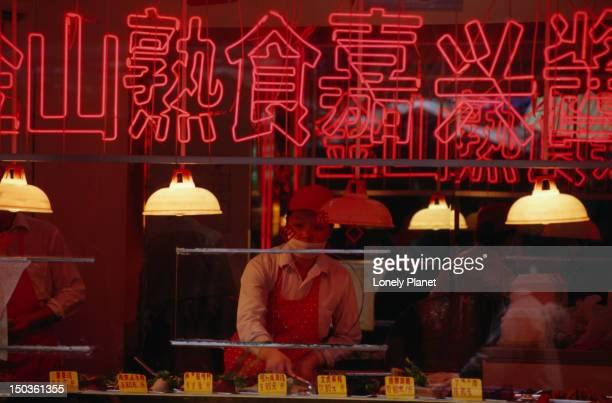 Restaurant worker behind sign.