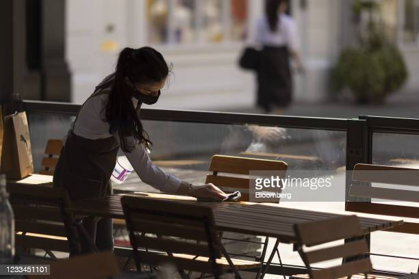 Restaurant worker cleans tables in London, U.K., on Monday, June 14, 2021. U.K. Prime Minister Boris Johnson is preparing to delay his plan to lift...