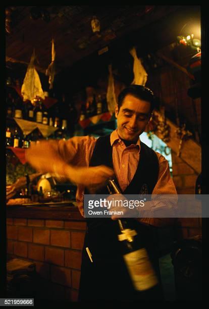 Restaurant Worker Opening a Wine Bottle