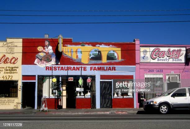 Restaurante Familiar at 4085 East Whittier Boulevard in East Los Angeles California has an image of a woman making tortillas painted above the door...