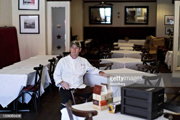Restauranteur Geoff Tracy sits for a photograph at Chef Geoff's restaurant in Washington DC US on Thursday March 26 2020 As the wheels of government...