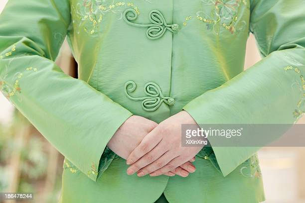 restaurant/hotel hostess, close-up on hands, front view - traditional clothing stock pictures, royalty-free photos & images