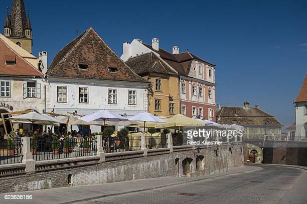 Restaurants line the Lesser Square in Sibiu, Romania