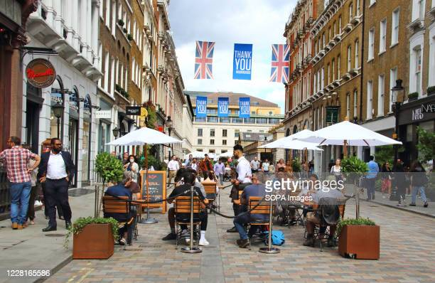 Restaurants look busier with the roads closed to traffic and many tables full of people enjoying the alfresco atmosphere. London's Covent Garden...