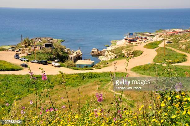 restaurants on the mediterranean beach in the raouche district, beirut, lebanon, middle east, orient - east stock pictures, royalty-free photos & images