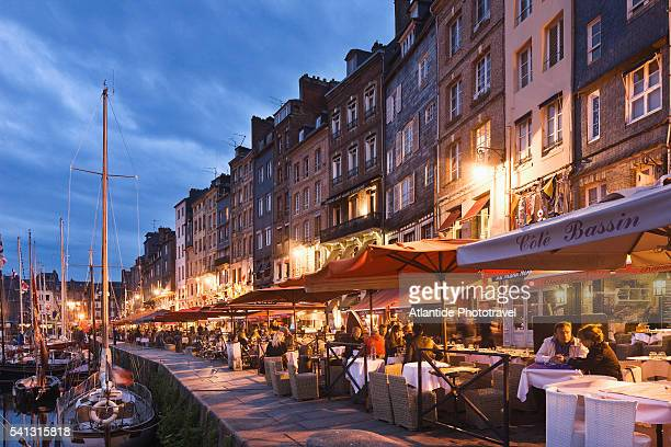 restaurants on the vieux bassin (old port) - calvados stock pictures, royalty-free photos & images
