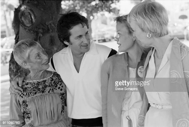 Restaurateur Leah Spielberg and her son film director Steven Spielberg pose outdoors with two unidentified women Los Angeles California 1981
