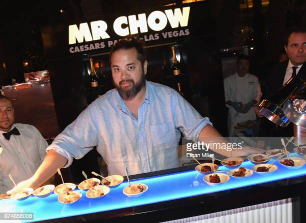 Restaurateur Maximillian Chow poses at the MR CHOW booth during the 11th annual Vegas Uncork'd by Bon Appetit Grand Tasting event presented by the...