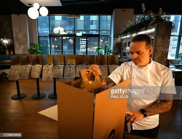 Restaurateur Simon Wood poses for a photograph at his restaurant, Wood Manchester, which offers high-end meal kits for delivery in Manchester,...