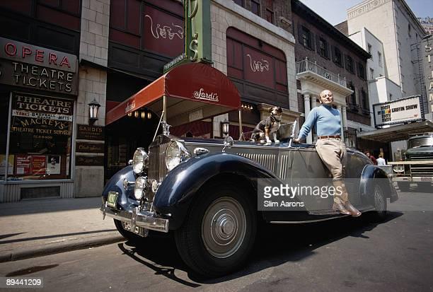 Restaurateur Vincent Sardi, Jr. Leans on a Rolls-Royce Phantom III outside Sardi's at 234 West 44th Street in Manhattan, June 1969. His parents...