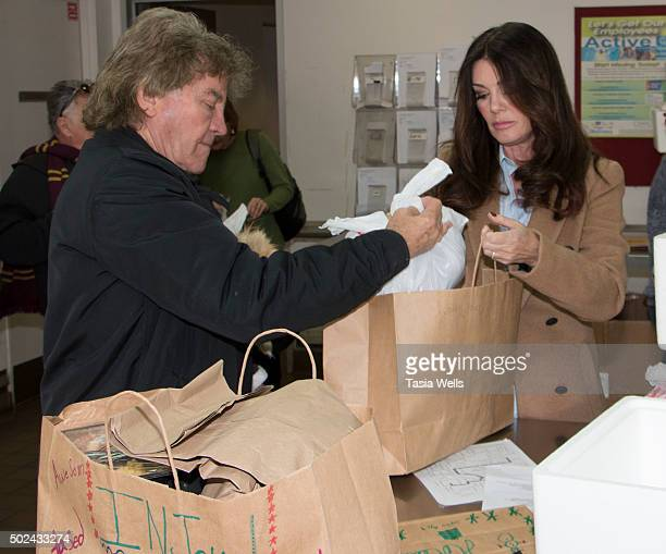 Restaurateurs Ken Todd and wife Lisa Vanderpump package holiday meals for delivery to Project Angel Food clients at Project Angel Food on December 24...