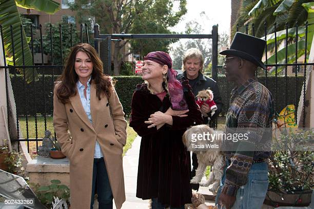 Restaurateurs Lisa Vanderpump and husband Ken Todd deliver holiday meals to Project Angel Food clients on December 24 2015 in Los Angeles California
