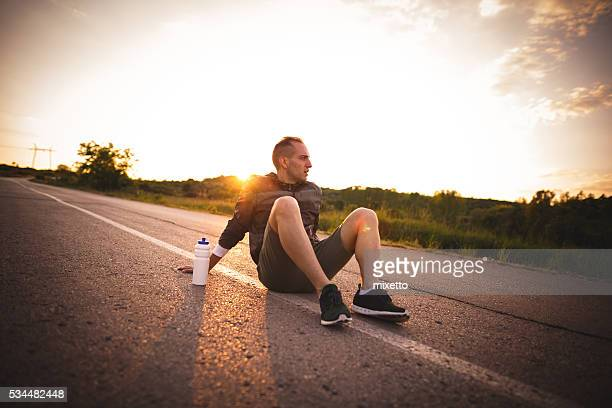 resting after training - men's track stock pictures, royalty-free photos & images