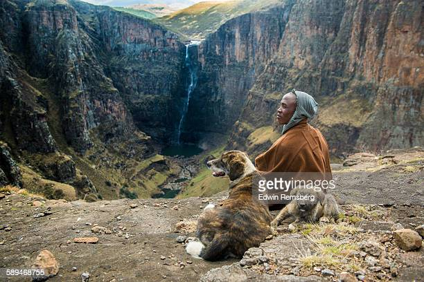 resting by the falls - lesotho stock photos and pictures