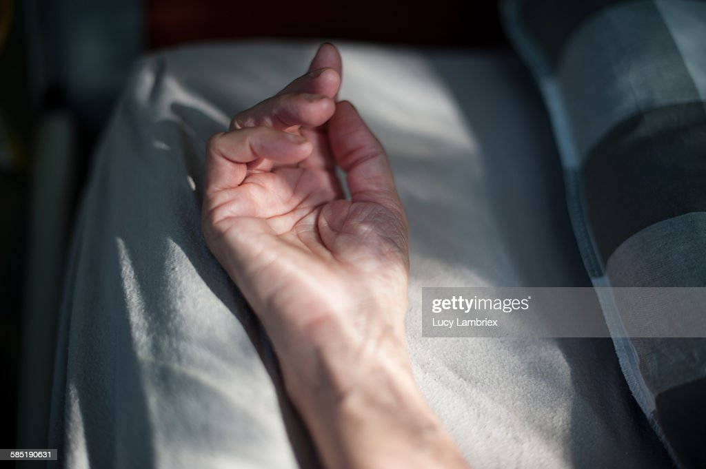 Resting hand in bed : Stock-Foto