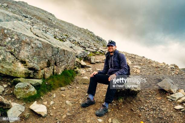 resting hiker - peter lourenco stock pictures, royalty-free photos & images