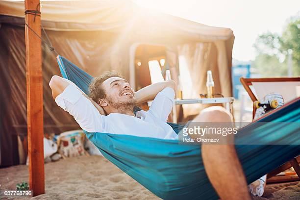 Resting in the hammock in a beach camp