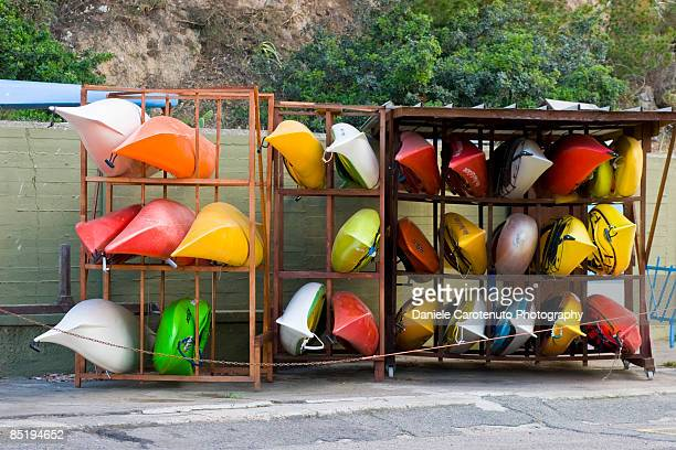 resting kayaks - daniele carotenuto stock-fotos und bilder