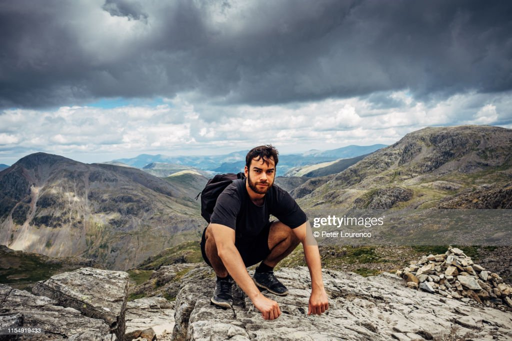 Resting on the Summit of scafell pike : Stock Photo