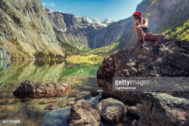 resting women in bavaria berchtesgaden obersee koenigssee - berchtesgaden stock photos and pictures