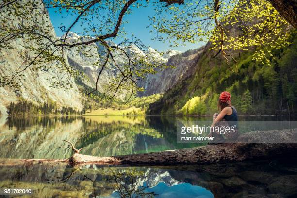 resting women in bavaria berchtesgaden obersee koenigssee - königssee bavaria stock photos and pictures