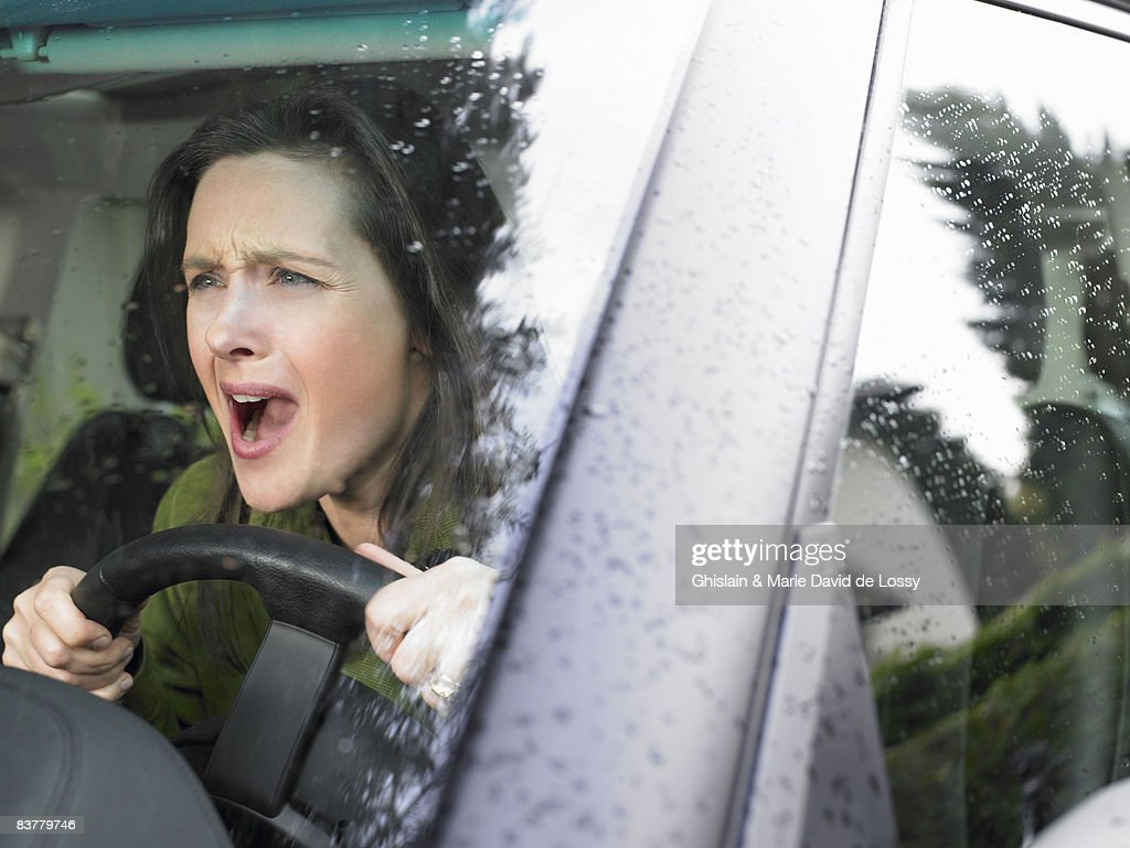 Restive woman driving : Stock Photo