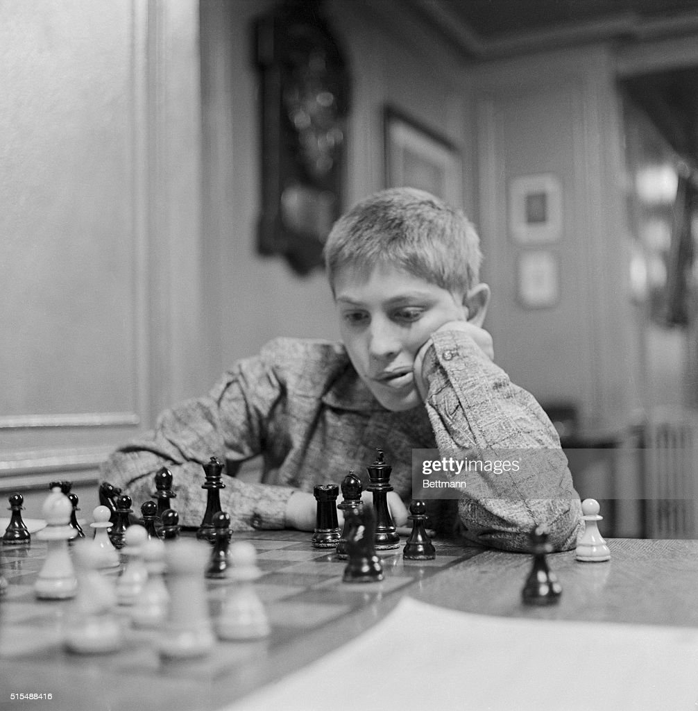 Bobby Fischer with One Hand on Jaw While Playing Chess : News Photo