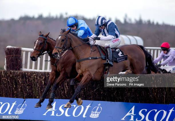 Restless Harry ridden by Charlie Poste beats Teaforthree ridden by Noel Fehily to win the Weatherbys Hamilton Insurance Steeple Chase during Ascot...