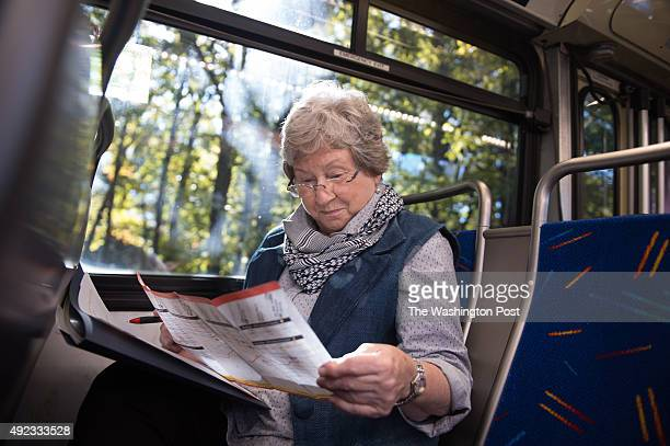 Reston resident Karen Wilson studies the Fairfax Connector schedule aboard the MATT bus during a handson learning session on the bus and Metro rail...