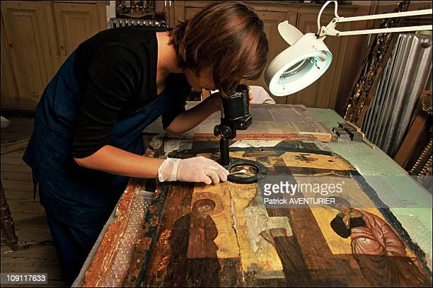 Restoration Of Mount Athos Icons On January 9Th Greece Istanbul Buyukada Island Inspecting An Icon Under Restoration Under A Binocular