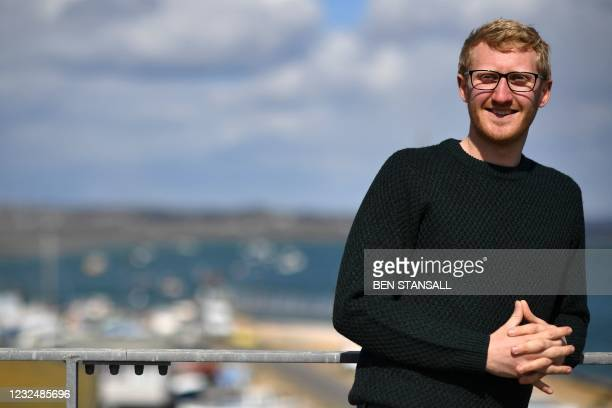 Restoration science officer, Luke Helmer poses for the photographer at an oyster hatchery, which aims to reintroduce millions of the European flat...