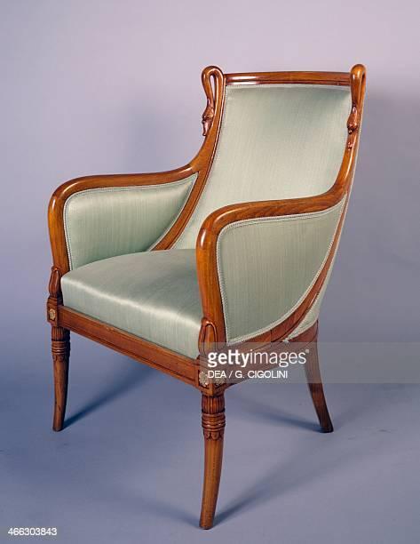 Restoration style blond mahogany gondola armchair 182025 one of a pair France 19th century