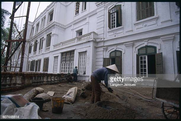 Restoration work is carried out on the old colonial building the Hotel Metropole which is being financed by FrancoVietnamese funds