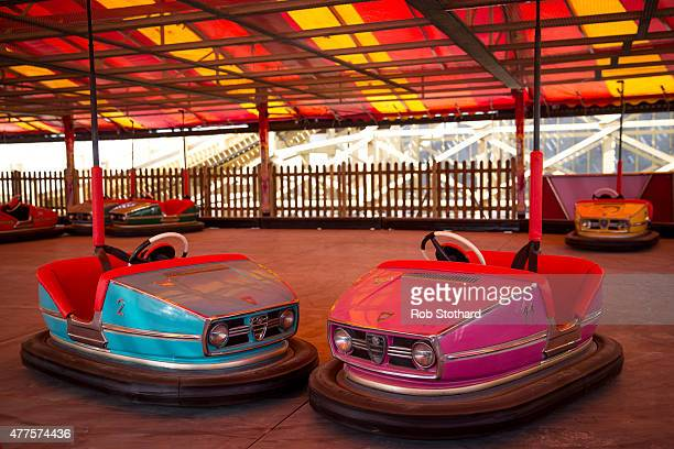 Restored cars wait to be ridden at the Dream Dodgems ride at Dreamland amusement park on June 18 2015 in Margate England Dreamland is considered to...