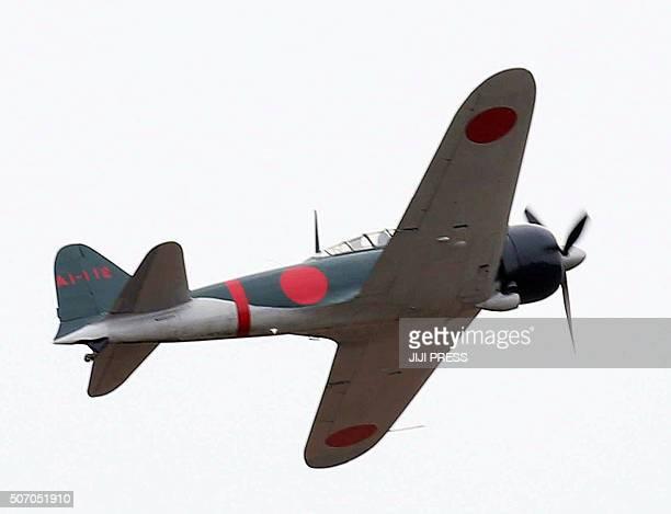 A restored World War IIera Mitsubishi A6M Zero fighter flies over Japan's Maritime Defence Force's Kanoya air base in Kanoya in Kagoshima prefecture...