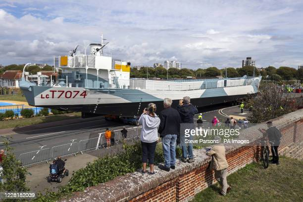 Restored World War Two landing craft LCT 7074 is transported from from the Naval Base in Portsmouth to its final resting place at the D-Day Story at...