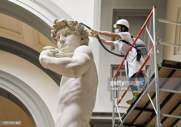 Restorer cleans Michelangelo's David statue while preparing for the reopening of the Galleria dell'Accademia which was closed for almost three months...