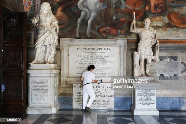 Restorer cleans the base of a statue on the first day of opening of the Capitoline Museums after more than two months of lockdown on May 19, 2020 in...