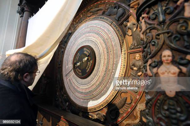 Restorer Marcus Mannewitz prepares the ceremonial inauguration of the new calendar disc at the astronomical clock in the Marien church in Rostock...