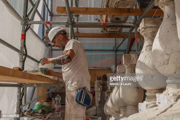 Restorer Ugo Calzavara is seen working on the famous Rialto Bridge on July 1 2015 in Venice Italy The Rialto Bridge is going through an 18months...
