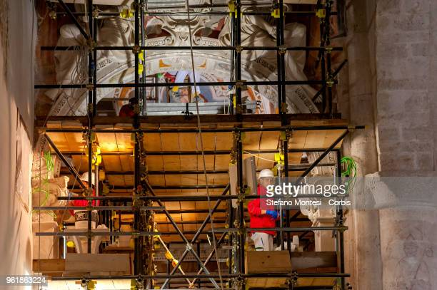 L' AQUILA ITALY MAY 23 Restorers inside the Branconio chapel once an altarpiece depicting the Visitation by Raphael in the church San Silvestro of L'...