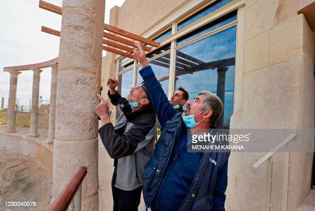 Restorers of the Israel Antiquities Authority work on the columns at the ancient theatre built by Herod the Great between 23-15 BCE in the Judaean...