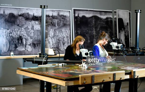 Restorers of the Royal Institute for Cultural Heritage remove surpeints and reveal the original of Adoration of the Mystic Lamb altarpiece by Van...