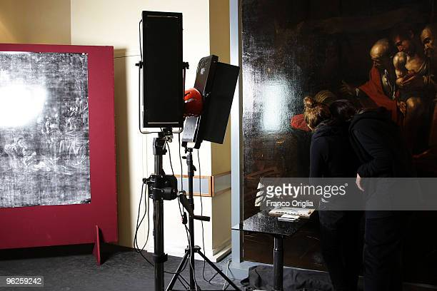 Restorers work on Caravaggio's masterpiece 'Adoration Of The Shepherds' during the open restoration at the Chamber Of Deputies facing Piazza del...