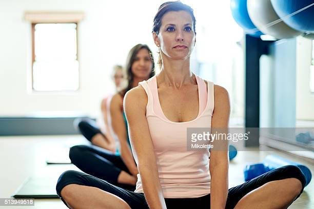 restoring calm and peace with pilates - good posture stock pictures, royalty-free photos & images