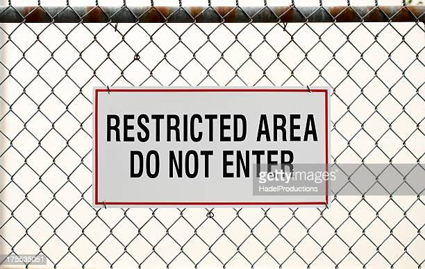Restricted area sign and fence