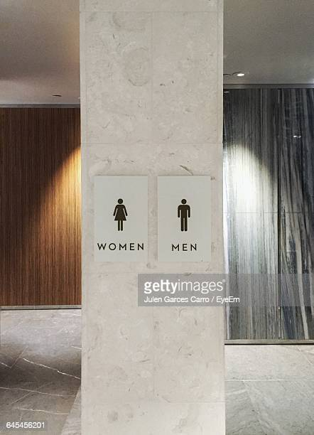 Restroom Signs On Column