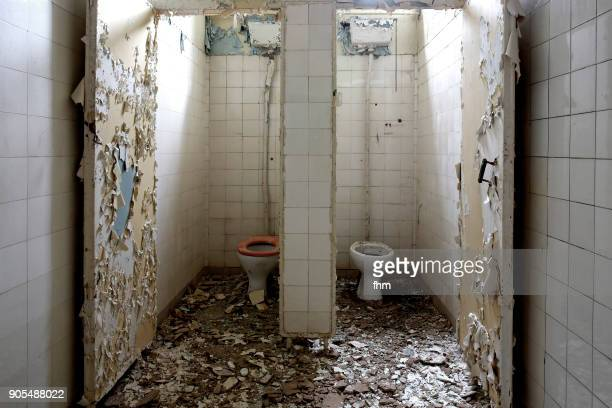 restrooms in an abandoned hospital - abandoned stock pictures, royalty-free photos & images
